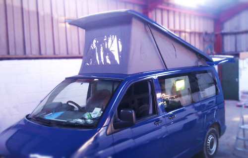 Blue VW Transporter fitted with Vanmax Poptop